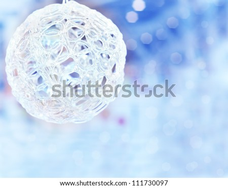 Christmas ball on the blurred blue background with copy space - stock photo