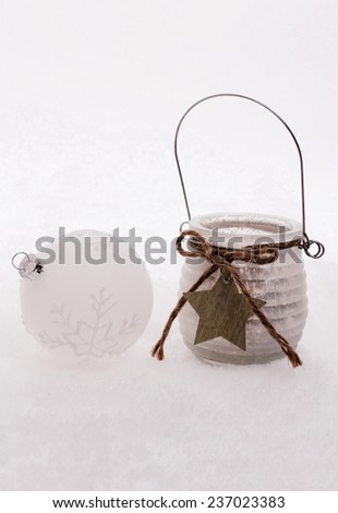 Christmas ball,  wind candle with star in snow, close up - stock photo