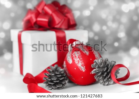 Christmas ball with a gift and a red bow - stock photo