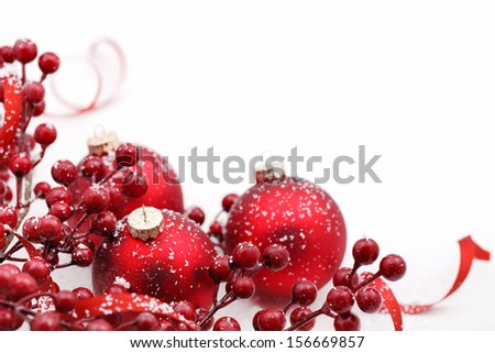 Christmas balls and berries on white background - stock photo