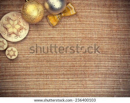 Christmas balls and candle on burlap background - stock photo