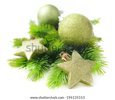 Christmas balls and decorative stars on fir tree, isolated on white - stock photo