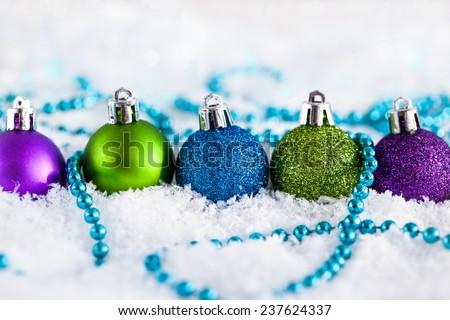Christmas balls and garland on the snow  - stock photo
