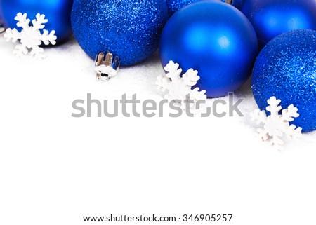 Christmas balls and snowflake on white background - stock photo