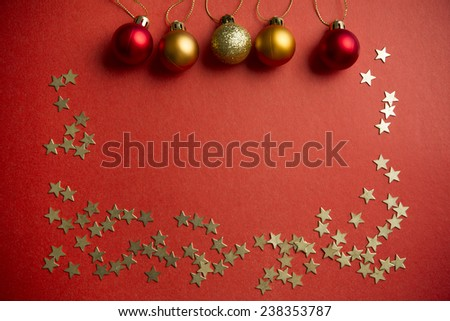 Christmas balls and stars to decorate on a red background. New year. - stock photo