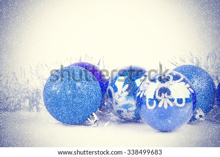 Christmas balls background blue and silver tinsel with space for text. vintage filter,soft focus - stock photo