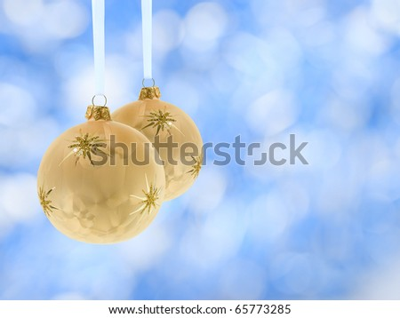 christmas balls decoration over blurred lights golden background - stock photo