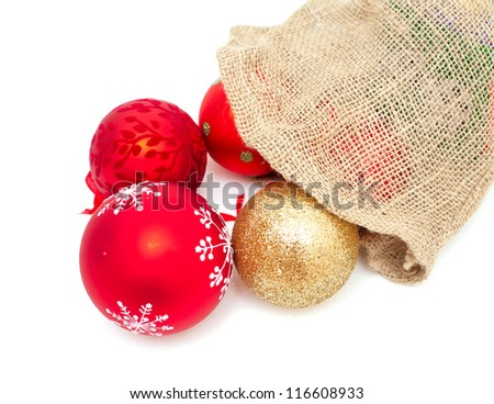 christmas balls falling from burlap bag - stock photo