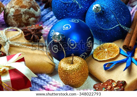 Christmas balls, gift boxes, dried fruit, cinnamon and cookies - stock photo