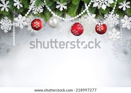 Christmas balls hanging on fir tree - stock photo
