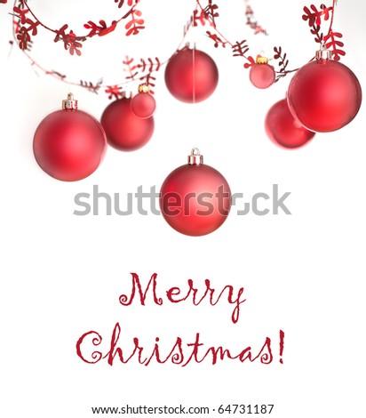 Christmas balls hanging on white background - stock photo
