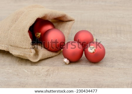 Christmas balls in Santa bag - stock photo