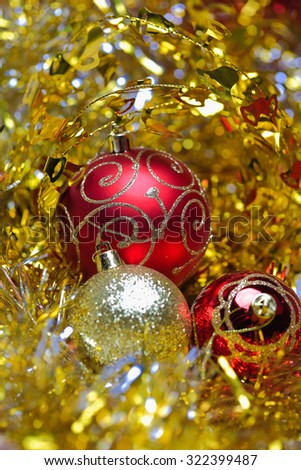 Christmas balls in the golden tinsel defocused backgrounds - stock photo