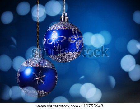 Christmas balls on a blue background. - stock photo
