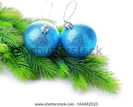 Christmas balls on fir tree, isolated on white - stock photo