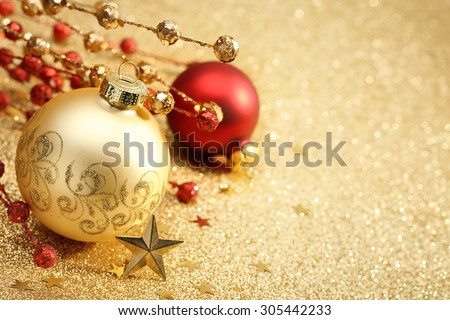 Christmas balls on golden background - stock photo