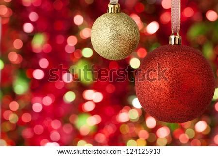 Christmas balls on illuminated background - stock photo