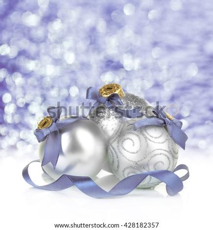 Christmas balls on shiny purple background - stock photo