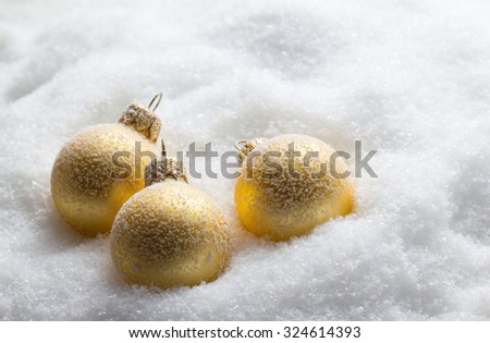 Christmas balls on snow - stock photo