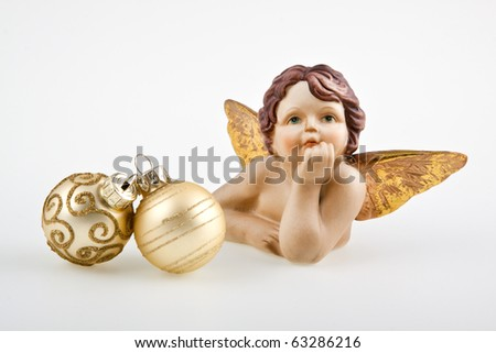 Christmas balls on white and angel. - stock photo