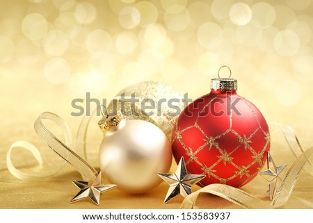 Christmas balls with ribbon on abstract background - stock photo