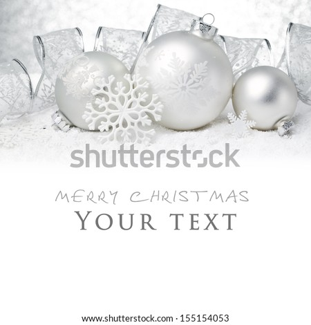 Christmas balls with ribbon on snow. - stock photo