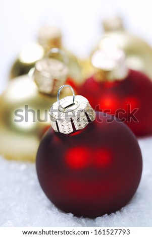 Christmas balls with snow on white  background - stock photo