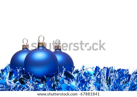 christmas balls with tinsel isolated over white background - stock photo