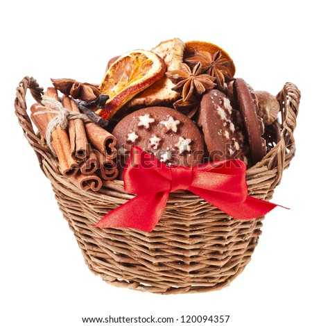 christmas basket full cookie and red ribbon bow on a white background - stock photo