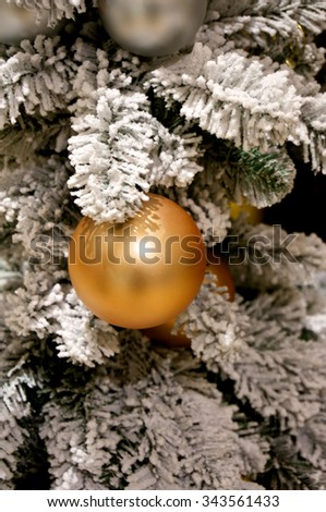 Christmas bauble on green snow tree - stock photo