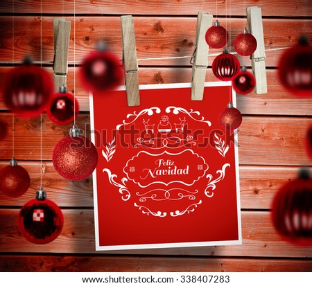 Christmas baubles against wooden background - stock photo