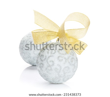 Christmas baubles and golden ribbon. Isolated on white background - stock photo