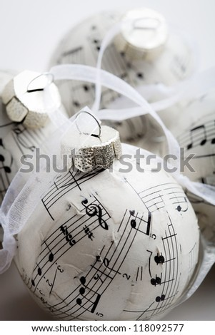 Christmas baubles made from old music book - stock photo