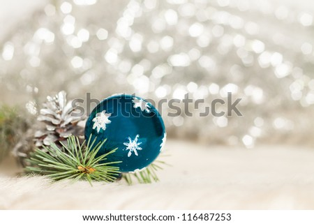 Christmas baubles on background of de focused lights - stock photo
