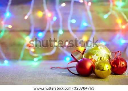 Christmas baubles on lights bokeh background with copy space - stock photo