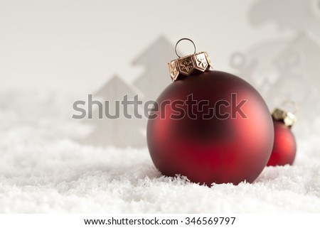 Christmas baubles on snow  - stock photo