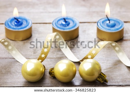Christmas baubles with candles, rustic style - stock photo