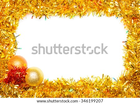 Christmas baubles with lights and tinsel frame on white background - stock photo