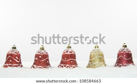 Christmas Bell Decorations In Snow - stock photo