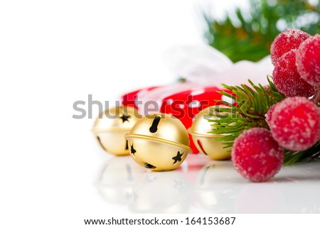 Christmas bells and xmas decoration on white background - stock photo