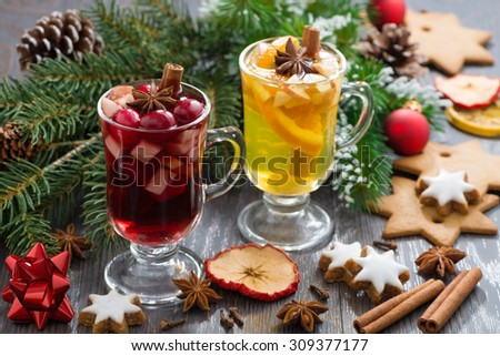 Christmas beverages, biscuits and spices on wooden table - stock photo
