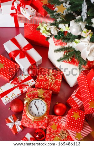 Christmas: big red gift box with red alarm clock - last minute christmas shopping - stock photo