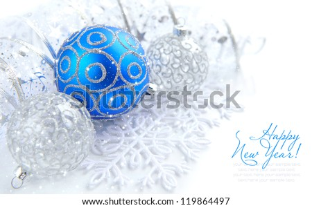 Christmas blue and silver decorations on white with sample text - stock photo