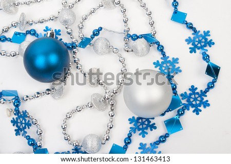 Christmas blue balls and beads on white - stock photo