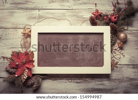 Christmas board design with poinsettia for greetings - stock photo