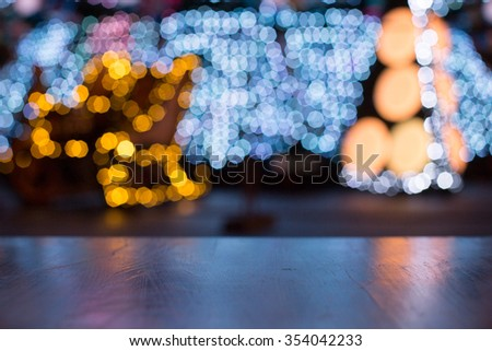 Christmas boke and wooden table. Background blur - stock photo