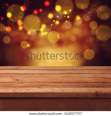 Christmas bokeh background with empty wooden table. Perfect for product display montage - stock photo