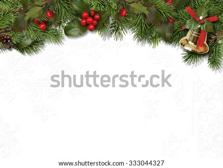 Christmas border branches and holly on white background - stock photo