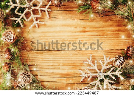 Christmas border design on the wooden background. - stock photo