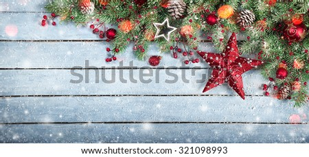 Christmas Border - Fir Tree and star On Wooden Background With Snowflakes And Lights  - stock photo